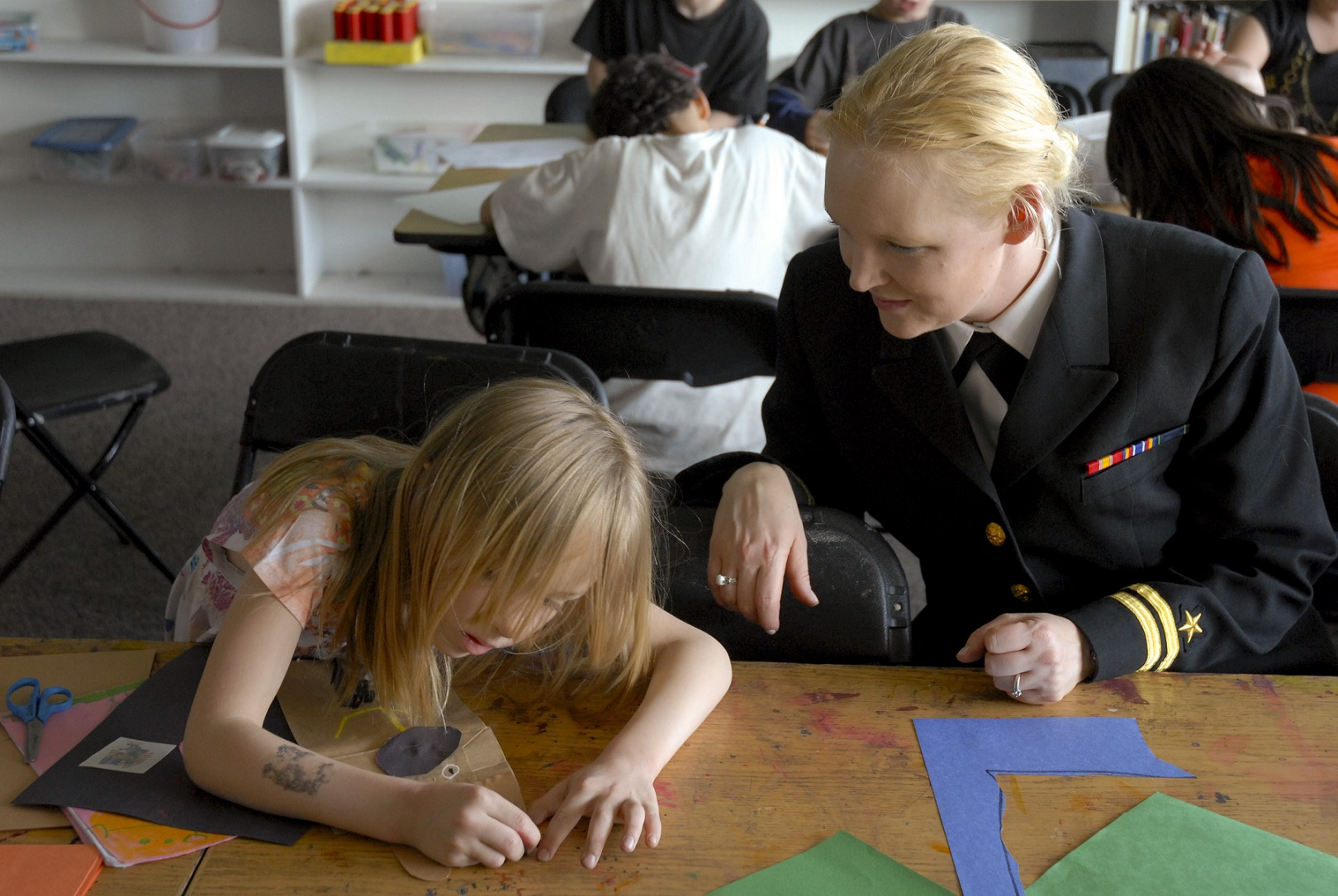 US_Navy_100512-N-0869H-119_Lt._Victoria_Tobin,_assigned_to_the_Navy_Office_of_Community_Outreach,_watches_a_member_of_the_Boys_and_Girls_Club_of_Spokane_County_during_a_Spokane_Navy_Week_event.jpg