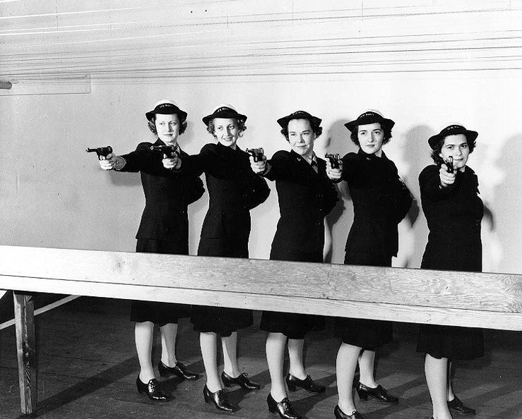 WAVES practice marksmanship at an indoor range at Treasure Island Naval Base, California, 11 February 1943. Their pistols are High Standard Model B types..jpg