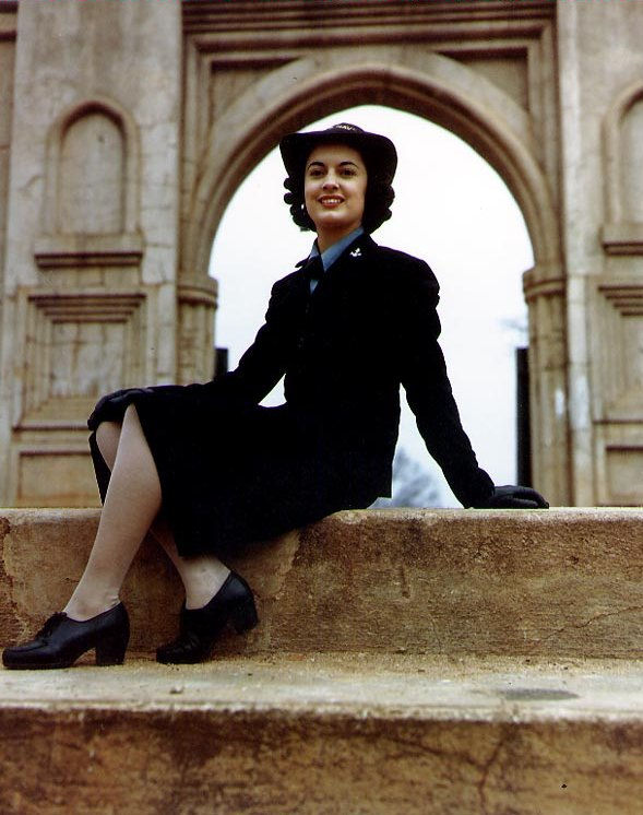 Yeoman 3rd Class Ellen Figg, USNR(W) poses by the entrance to the Old Capitol Grounds, Milledgeville, Georgia, while attending the Naval Training School, Yeoman-W, in that city during World War II..jpg
