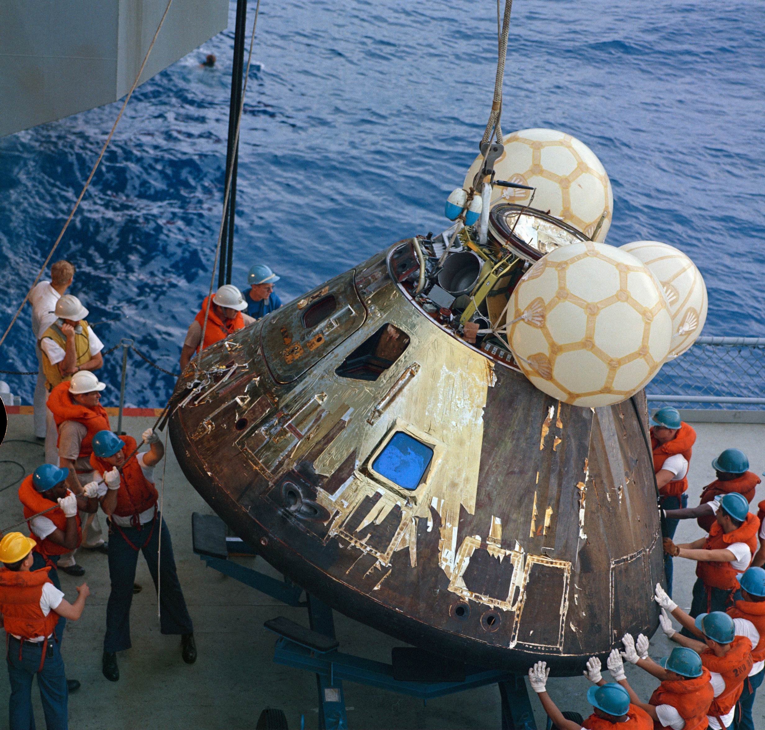 USS Iwo Jima (LPH-2) used as a prime recovery ship for the Apollo 13 mission, guide the Command Module (CM) atop a dolly onboard the ship - NASA photo, 17 April 1970.jpg